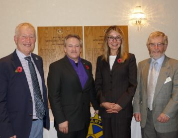 Carol Gandey with Andrew Van Buren and members of Rotary Club